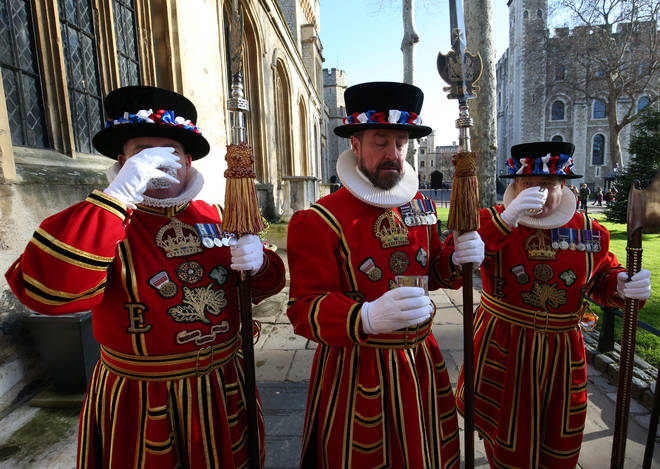 Yeoman Warder's (more commonly known as Beefeaters) enjoy a toast following their Christmas State Parade in the Tower of London.