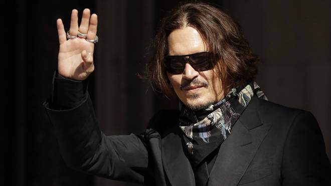 Johnny Depp is suing the Sun's publisher over an article that labelled him a 'wife beater'