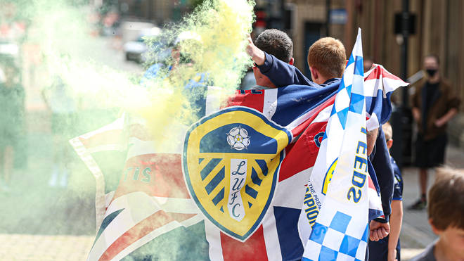 Thousands of Leeds United fans took to the streets to celebrate their team's promotion