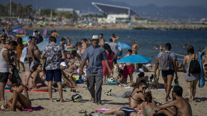 Spain has limited access to beaches in Barcelona after a surge of new infections