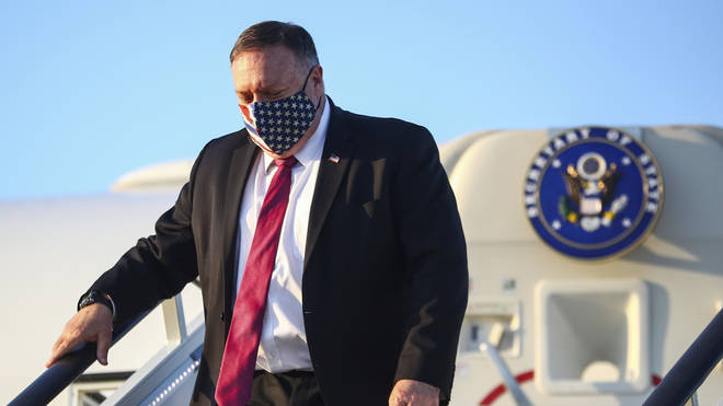 Mike Pompeo wears a stars and stripes face mask as he arrives in London for trade talks