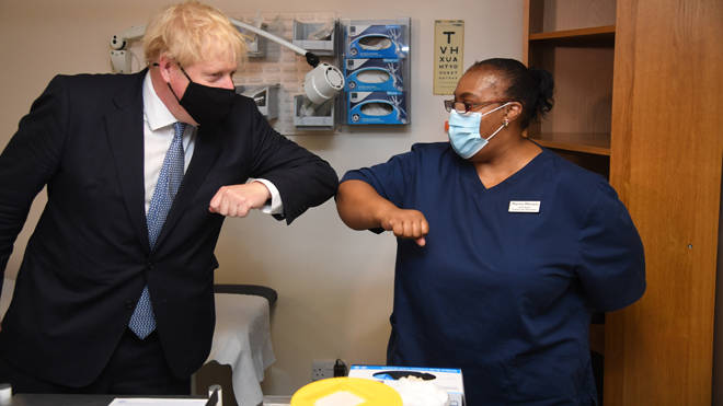Boris Johnson meets staff at a GP in east London today