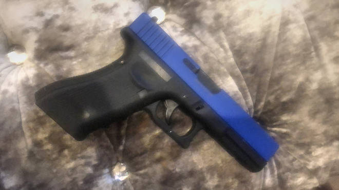 The gun was a BB pellet gun fitted with a blue slider to distinguish it from a real one
