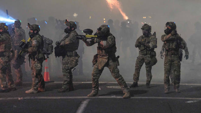 Police in Portland fired tear gas at protesters amid violent standoffs