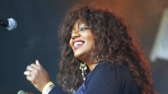 Denise Johnson performs on stage