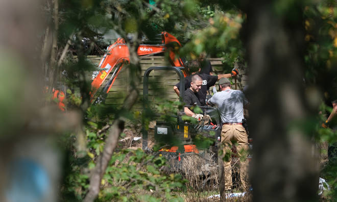 An excavator has been pictured at the scene of the search