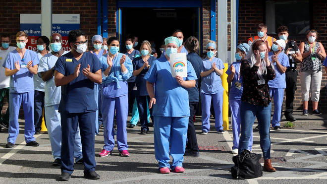 File photo: NHS staff outside the William Harvey Hospital in Ashford, Kent, join in the pause for applause to salute the NHS 72nd birthday