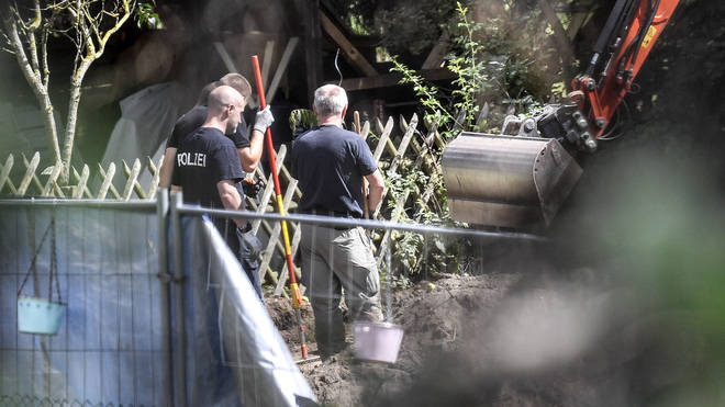 Police search an allotment near to where the German suspect lived, according to local reports