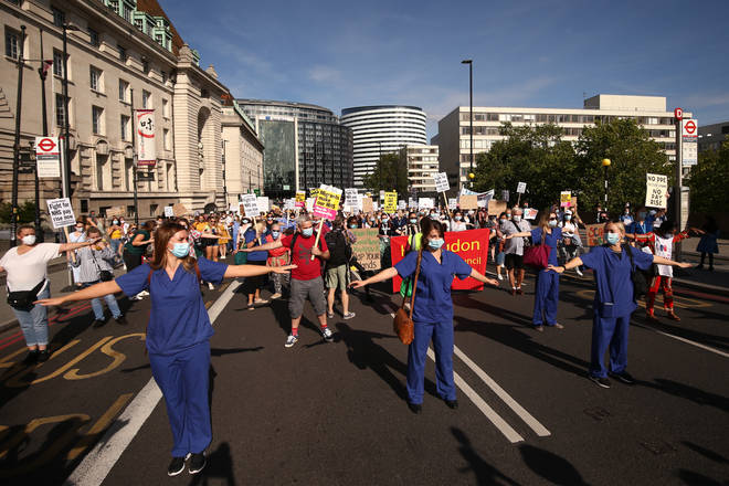 NHS workers march from St Thomas' Hospital to Downing Street, London, to demand a pay rise
