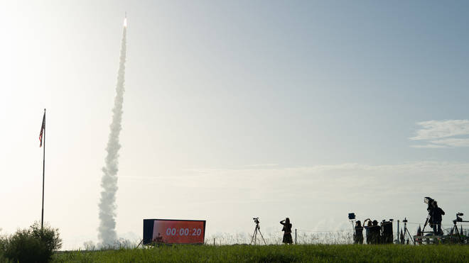 Onlookers watched as the Atlas 5 rocket launched on Thursday