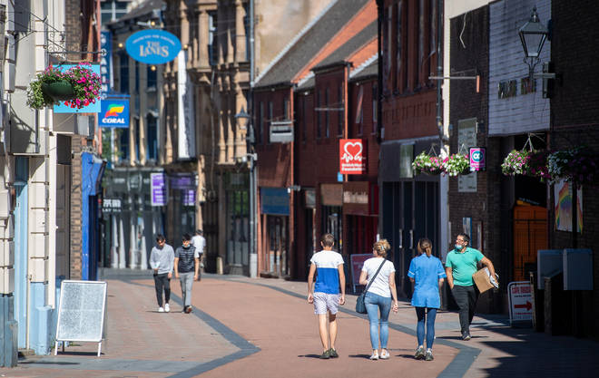 People walk along Silver Street in Leicester as a decision is due to be made on whether to lift the lockdown restrictions in the city