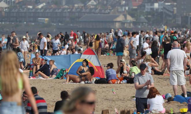 People enjoying the weather on Portobello Beach in Edinburgh