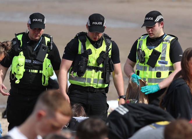 Police at Portobello Beach in Edinburgh confiscated alcohol from beachgoers and broke up large crowds