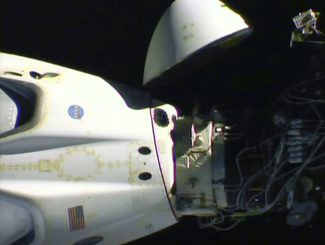 An image released by Nasa shows the Crew Dragon capsule detaching from the International Space Station