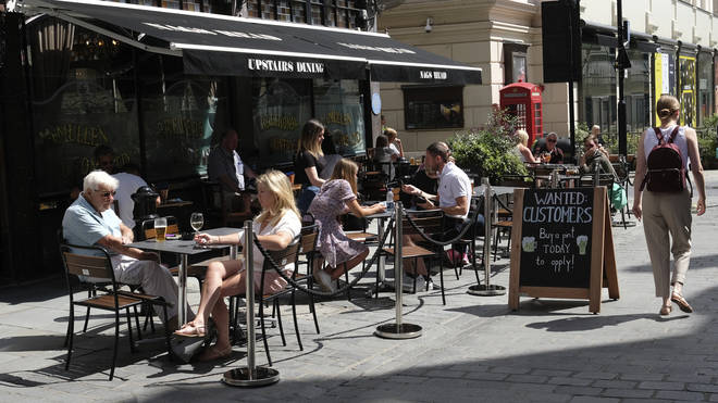 A restaurant in central London on Monday carries the sign 'wanted: customers'