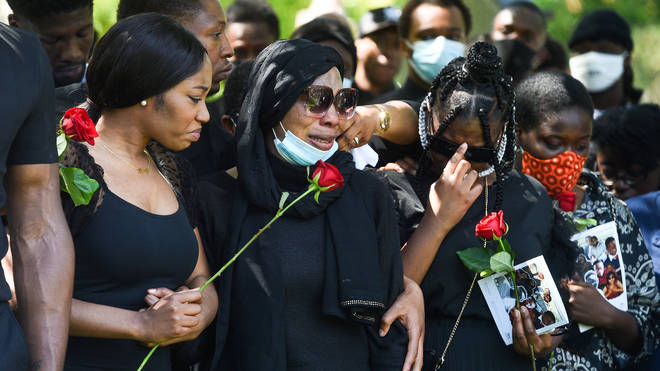 Khaji and Alex's mother Victoria mourn together at his funeral