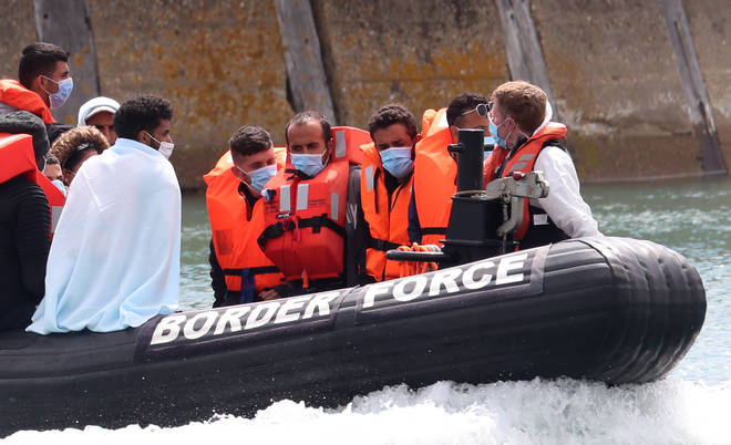 Men wearing masks and lifejackets were brought to shore at Dover on Tuesday