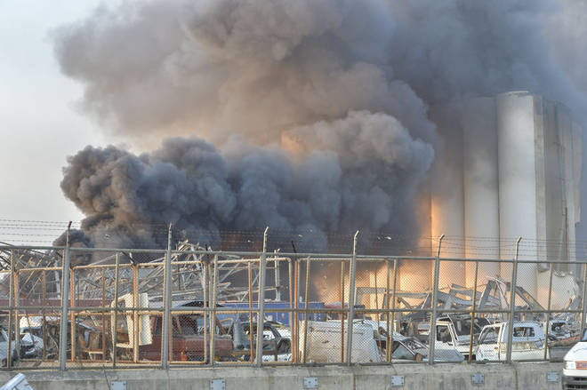 Smoke rises after a fire at a warehouse with explosives at the Port of Beirut