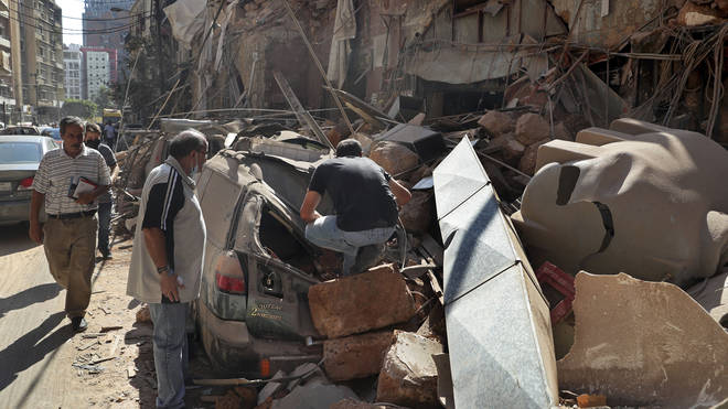 Locals comb through the wreckage to find survivors