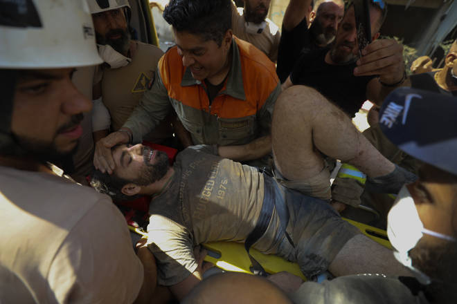The man, whose name is unknown, was pulled from the rubble after ten hours