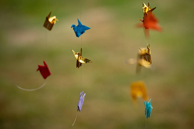 Origami paper cranes can be seen throughout the city.