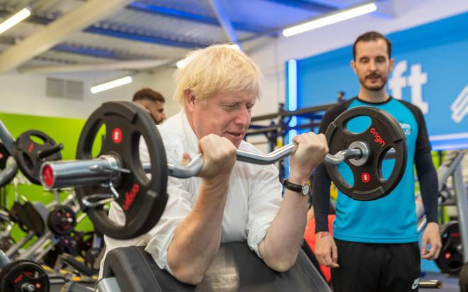 Boris Johnson pumps iron during a trip to a South Ruislip gym