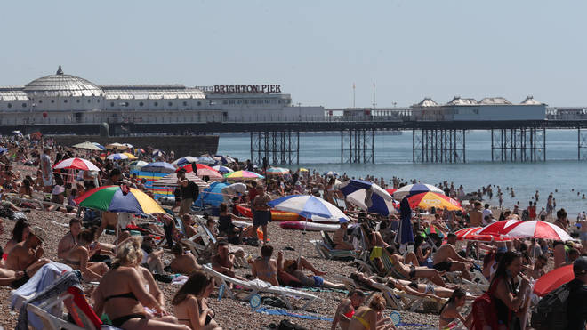 Hundreds of people descended to the coast across Britain on Friday morning as early as 9am