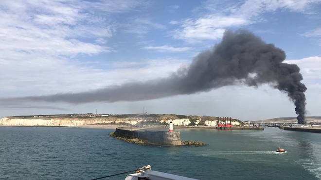 A huge plume of smoke was pictured rising from the industrial unit in Newhaven