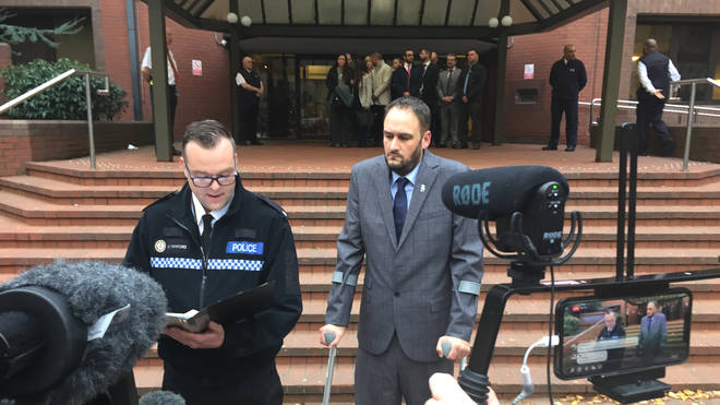 Pc Gareth Phillips (right ) outside Birmingham Crown Court after Mubashar Hussain was jailed for 12 years