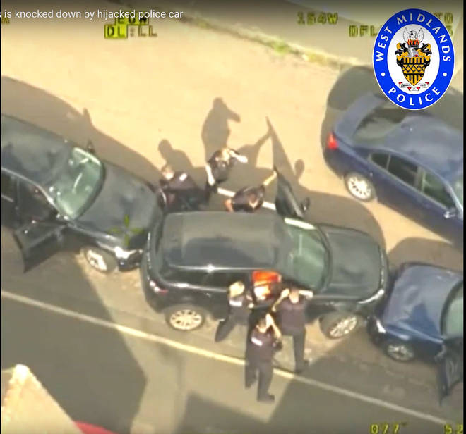 Videograb from police helicopter footage issued by West Midlands Police of police surrounding a Range Rover, stolen by Mubahsar Hussain
