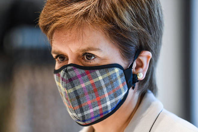 "Nicola Sturgeon has issued a ""yellow card"" to football bosses over coronavirus breaches"