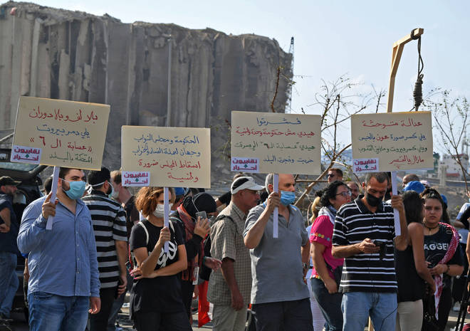 Lebanese protesters lift a gallows and placards berating politicians in Beirut