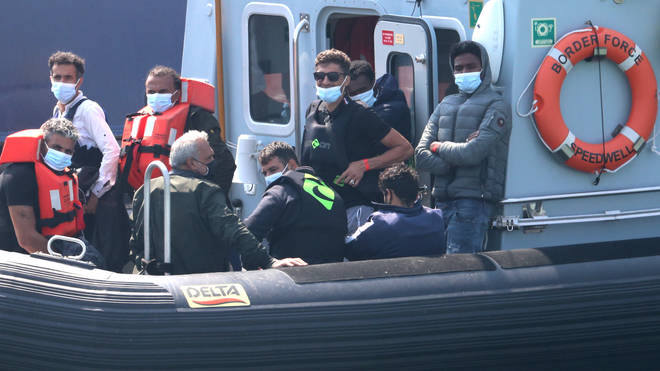 A group of people thought to be migrants are brought into Dover, Kent, by Border Force officers following a number of small boat incidents in the Channel on Wednesday