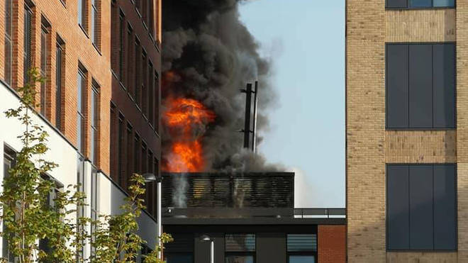 Flames leap from Swansea University's Bay campus after a fire broke out