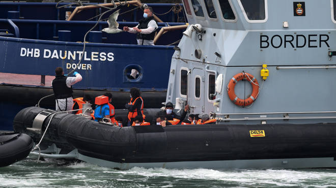 More migrants wearing face masks and orange life-jackets were seen coming into Dover port aboard Border Force vessels on Wednesday