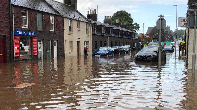 Flooding in Stonehaven, Aberdeenshire in Scotland, where a nearby train derailed.