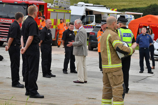 Prince Charles has met with emergency responders at the site of the fatal Stonehaven train crash which killed three people.