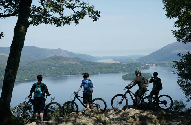 Cyclists marvelled at Derwentwater near Keswick, in the Lake District, on Saturday ahead of thunderstorms