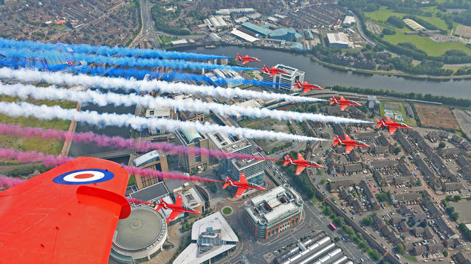 Ministry of Defence handout photo of The Red Arrows, carrying out a flypast over Belfast