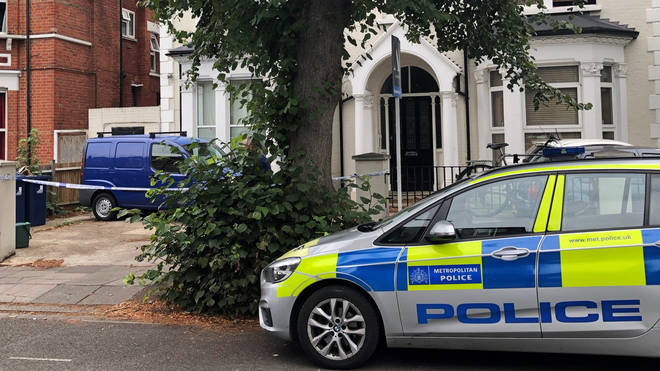 Police outside an address in Cumberland Park, Acton, west London