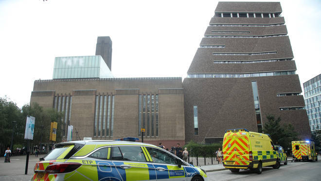 Police at the scene where the boy was thrown from the Tate Modern