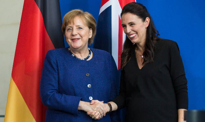 Angela Merkel (L) and Jacinda Ardern (R) have overseen lower Covid-19 death rates in Germany and New Zealand