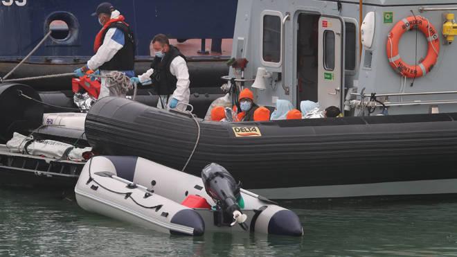 Migrants being brought ashore in Kent last week - file image