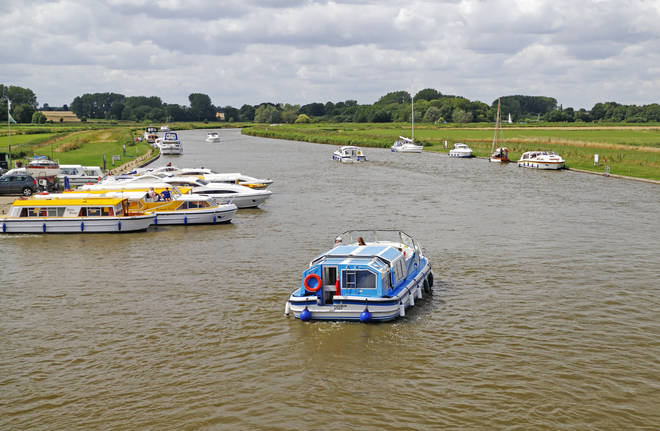 The woman became 'trapped under a boat' on the River Bure (file photo)
