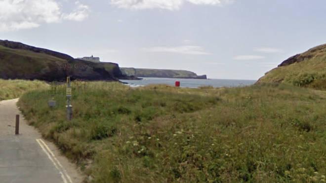 The man got into difficulty in the sea off Gunwalloe, in Helston