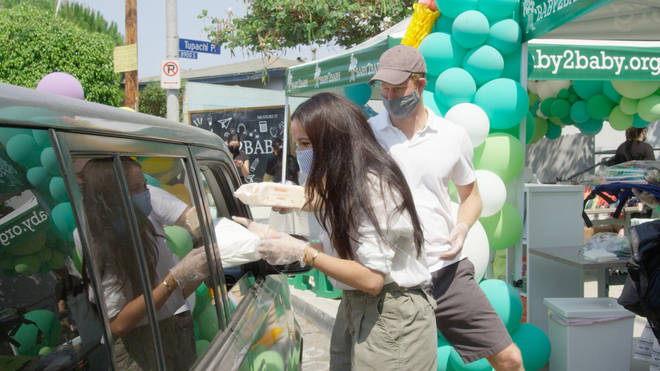 Harry and Meghan distributed supplies, clothes and nappies at a drive-through run by charity Baby2Baby