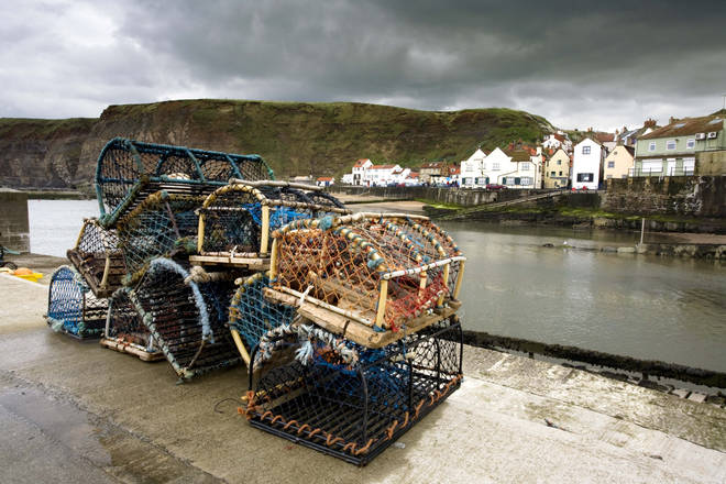 File photo of lobster traps along the harbour in Staithes