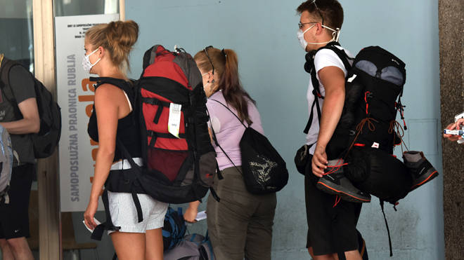 Tourists with suitcases and bags leave the city, in Sibenik, Croatia