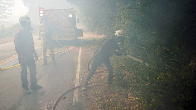Civilian firefighters assist with tackling the flames in California