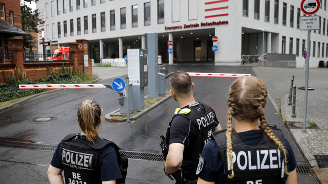 German police officers stand in front of the emergency entrance of the Berlin Charite hospital where Alexei Navalny is expected to arrive